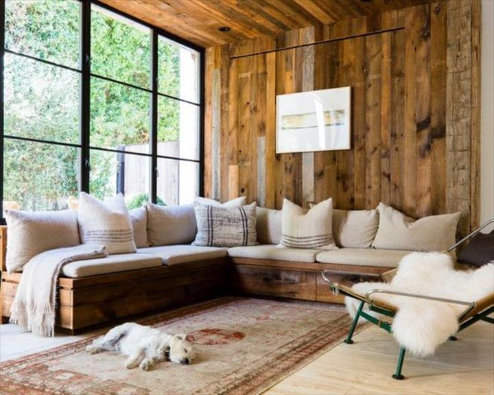 vintage-inspired-wooden-pallet-corner-sofa-with-white-cushions-and-pillows